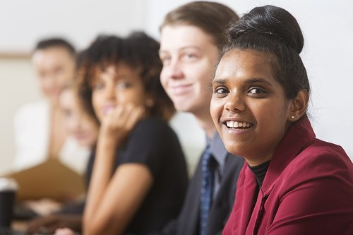 young professional Aboriginal girl with colleagues